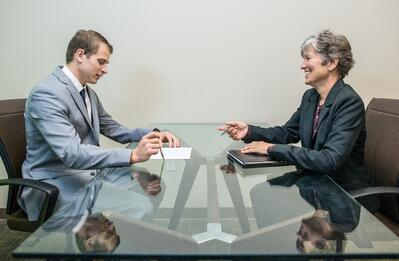 Young man in interview with mature woman