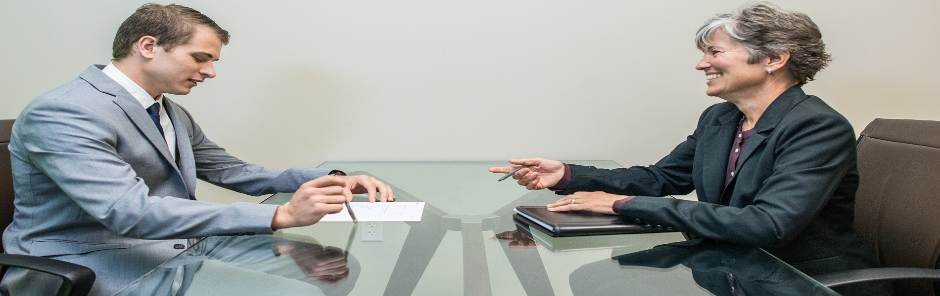 Young man in job interview with mature lady