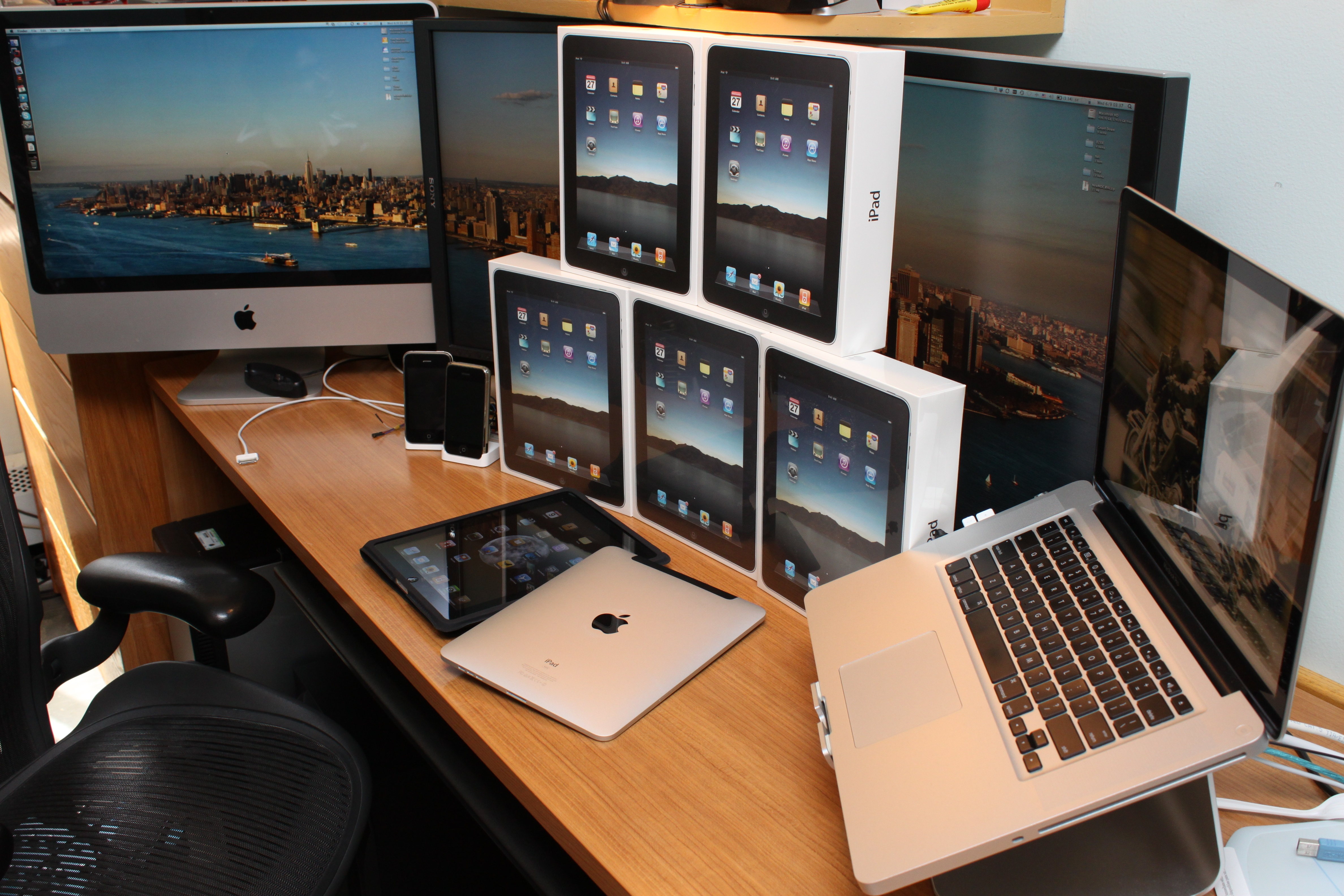 Office desk with imac, iphone and lots of ipads