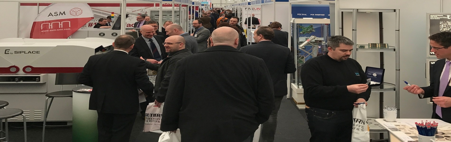 visitors attending a manufacturing trade show