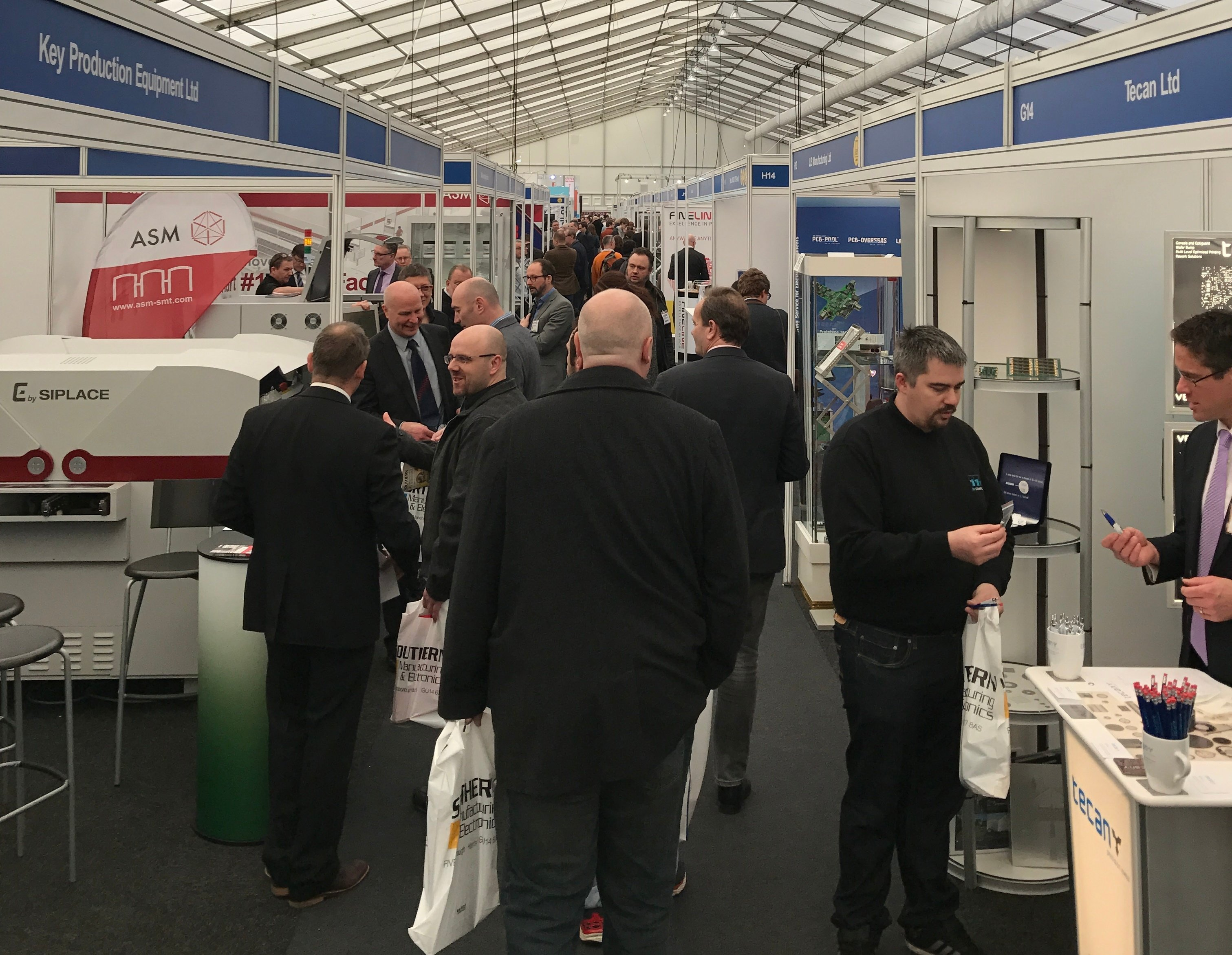 visitors attending an electronics and manufacturing exhibition